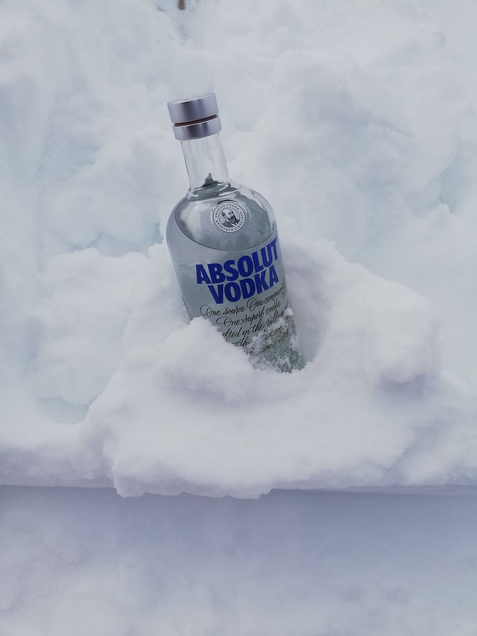 vodka bottle in the snow